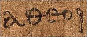 "The Greek word 'αθεοι' (atheoi), as it appears on this ancient papyrus in the New Testament's ""Epistle to the Ephesians"" (2:12). It is usually translated into English as ""[those who are] without God."" Photo: Wikimedia"