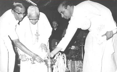 In this archival photo, a much younger Fr. Albert, on the right, joins his colleagues in 'lighting the lamp' going from darkness to light, a ritual which preceded all the meetings of the World Fellowship of Interreligious Councils. – Photo: WFIRC