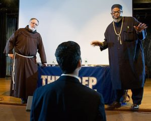 Father Steven Pavignano (l.) and Imam Talib Abdur-Rashid address a student during an interfaith dialogue at Seton Hall Preparatory School. – Photo: Interfaith Center of New York