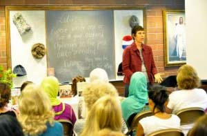 Nancy Davis, a cancer survivor, speaks to a room filled with women on how to handle unexpected challenges in life. Photo: Kathe Espinili