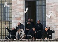 Franciscan friars free doves during the interfaith peace meeting at the Basilica of St. Francis in Assisi, Italy, Oct. 27. Photo: Giampiero Sposito, Reuters
