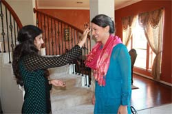 Namita Pallod welcomes Tulsi Gabbard to her father's Houston home for a recent fundraiser. RNS photo: Courtesy Vijay Pallod