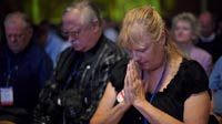 Attendees pray during The Family Research Council's Values Voter Summit on Sept. 14 in Washington, D.C