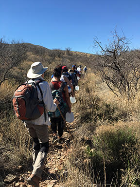 USC students with water jugs walk south towards the U.S.-Mexico boarder. – Photo: Jim Burklo