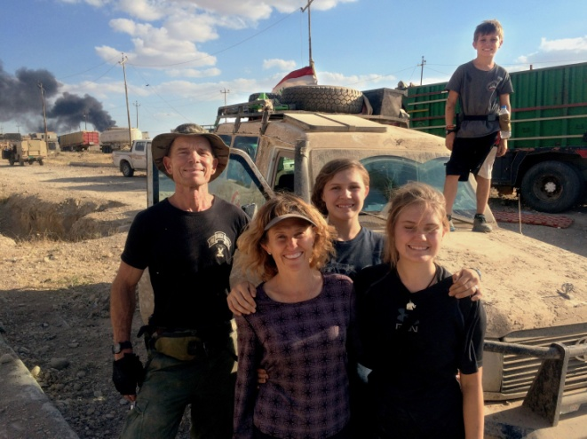 David and Karen Eubank with their children Sahale, 16, Suuzanne, 14, and Peter, 11, next to their armored ambulance in Mosul. – Photo: Washington Post, Family Photo
