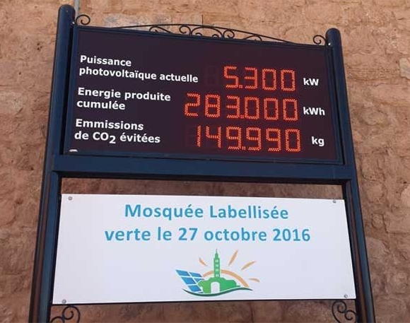 Koutoubia Mosque in Marrakech, Morocco, showing its solar energy production panel — placed prominently at the entrance to the mosque so that the faithful can see it when entering and feel proud of their accomplishment. Photo taken after Friday prayer in November 2016 during COP22. – Photo: Nana Firman