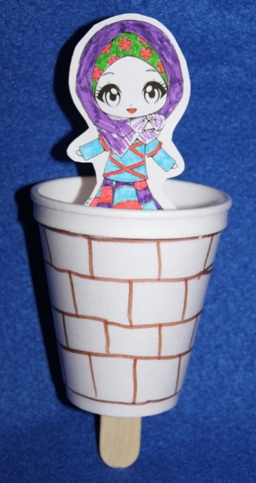 Sample craft made in our Lower Elementary class. The craft stick can be moved up and down as though the woman were going in and out of the well – Photo: VG