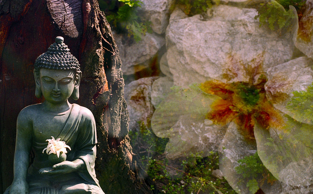 Buddha meditating in nature – Photo:  Benjamin Balázs, C.c. 2.0