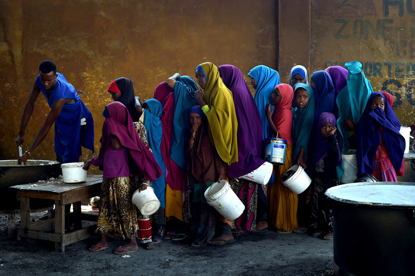 Young girls line up at a feeding center in Mogadishu – Photo: Tobin Jones, United Nations