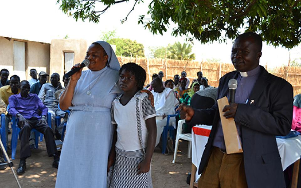 Refugees speak during Interfaith Harmony Week event – Photo:  URI