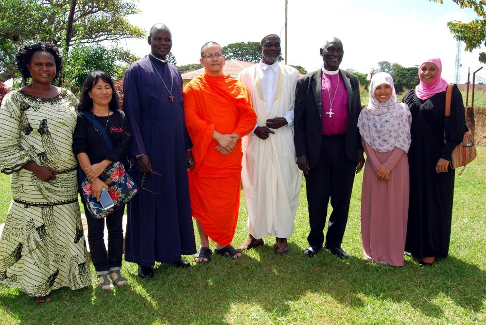 An interfaith gathering in the Great Lakes region of Africa. Despina is on the left. Photo: URI Great Lakes Region, Facebook