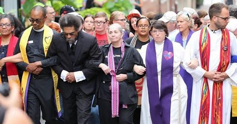 Clergy in Charlottesville counter the alt-right white supremensists. – Photo: CBS News Video