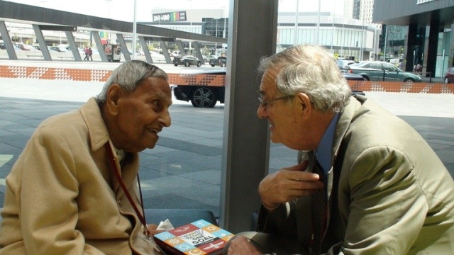 Bill, talking with Dada J.P. Vaswani at the Melbourne Parliament in 2009 – Photo: Complete Wellbeing