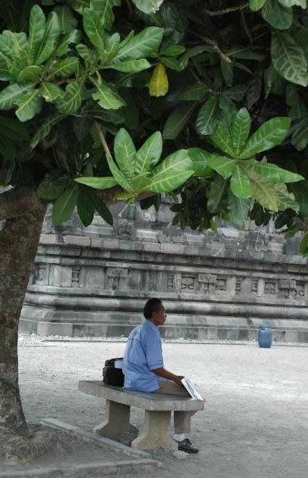 Man sitting outside Gedung Batu Temple – Photo: RS
