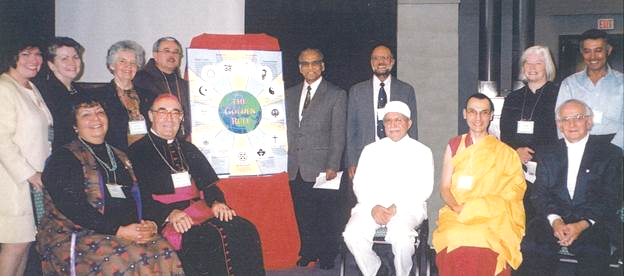 These 13 individuals represent the 13 traditions whose golden rule texts are used on the poster. Leslie Mezei is seated on the far right – Photo:    Scarboro Missions
