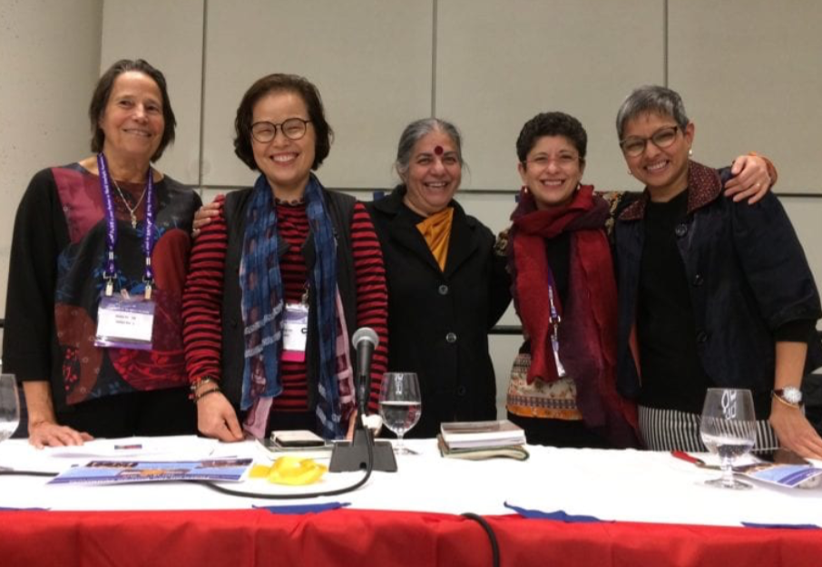 Women of Faith Speak Out: Towards Resetting the Global Moral Compass presentation at the Parliament of the World's Religions, 2018. From right: Alison Van Dyk, Chung Ohun Lee, Vandana Shiva, Azza Karam, Lopa Banerjee –   Photo: Grove Harris