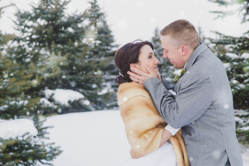 """Reagan + Aaron - """"Becca was amazing to work with! She was so easy going and knew exactly what to do! My wedding was basically in the middle of a blizzard and she was ready to go! She made it a point to be exactly where she needed to be no matter the weather! She suffered in the bitter cold with us and never once complained! She came through with AMAZING pictures! I couldn't have imagined anything better! This woman is amazing! I will forever recommend her!"""""""
