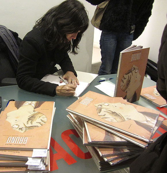 Signing books at the opening