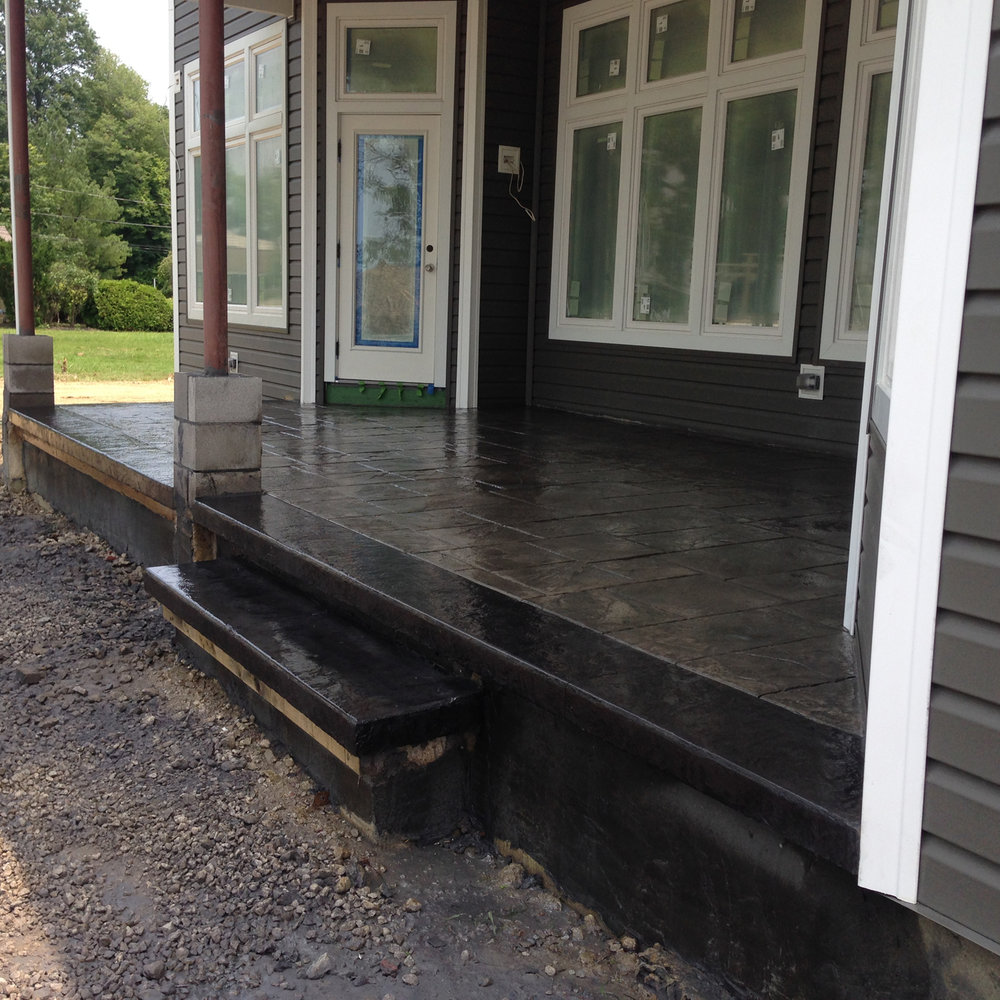 Large Ashlar Slate stamped porch w/ Slate integral color and Dark Gray release & color hardener.