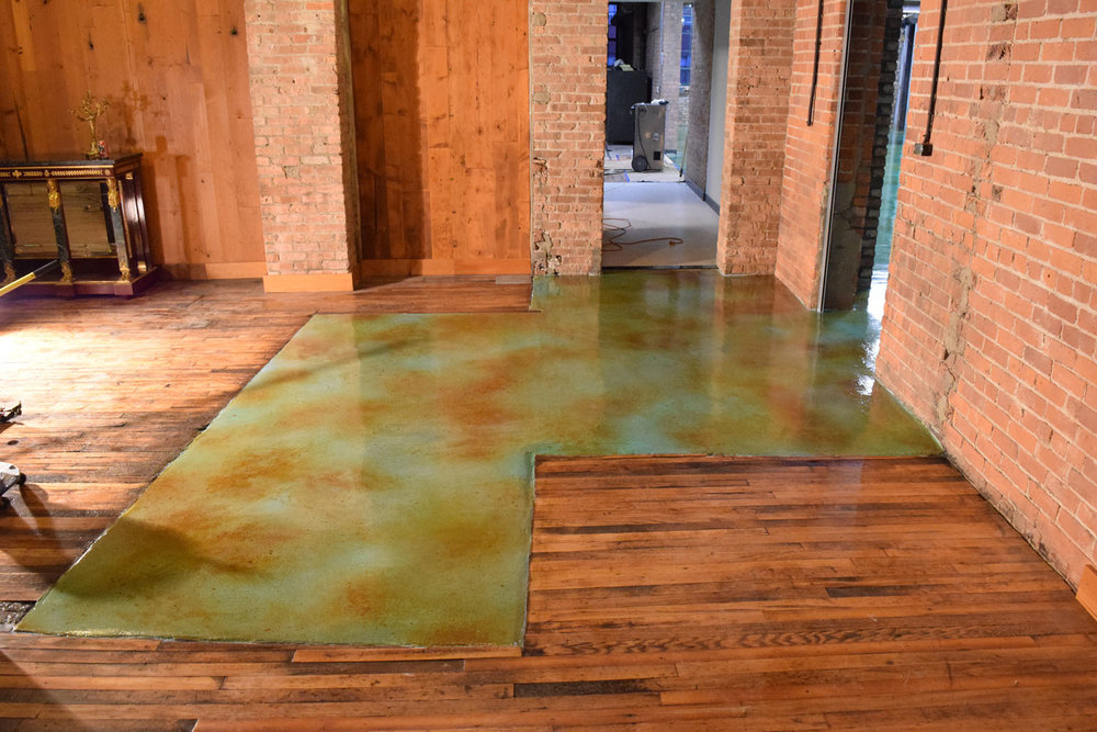 Acid-Stained, Colored Cement Overlay Flooring.  Brickform SM Pro, Microtopping, Blushtone, and Decopoxy