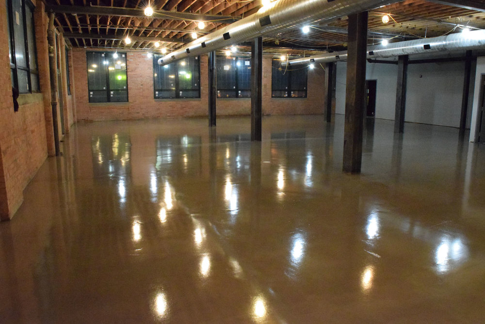 Sealed Gray Retail Concrete Overlay.  Brickform Decopoxy