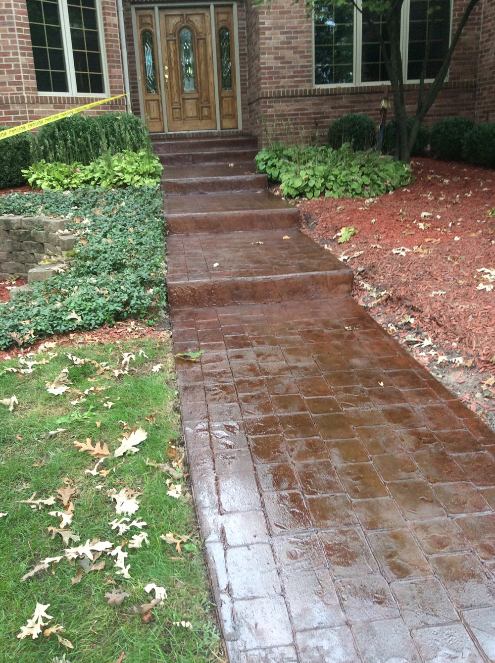 "Sidewalk had been damaged from salt.  Powerwashed and patched stone pops with Brickforms 1/4"" Stampable Overlay, blended colors with Brickforms colors, then used Brickforms Solvent Based Sealer Gem-Seal"