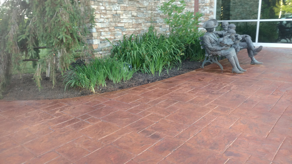 This photo is of a stamp restoration project. After years of sitting and lack of color; we were able to bring this office courtyard back to life, with Brickform Artesian water based stains. Gem seal was used to coat the canvas and really make the colors pop!
