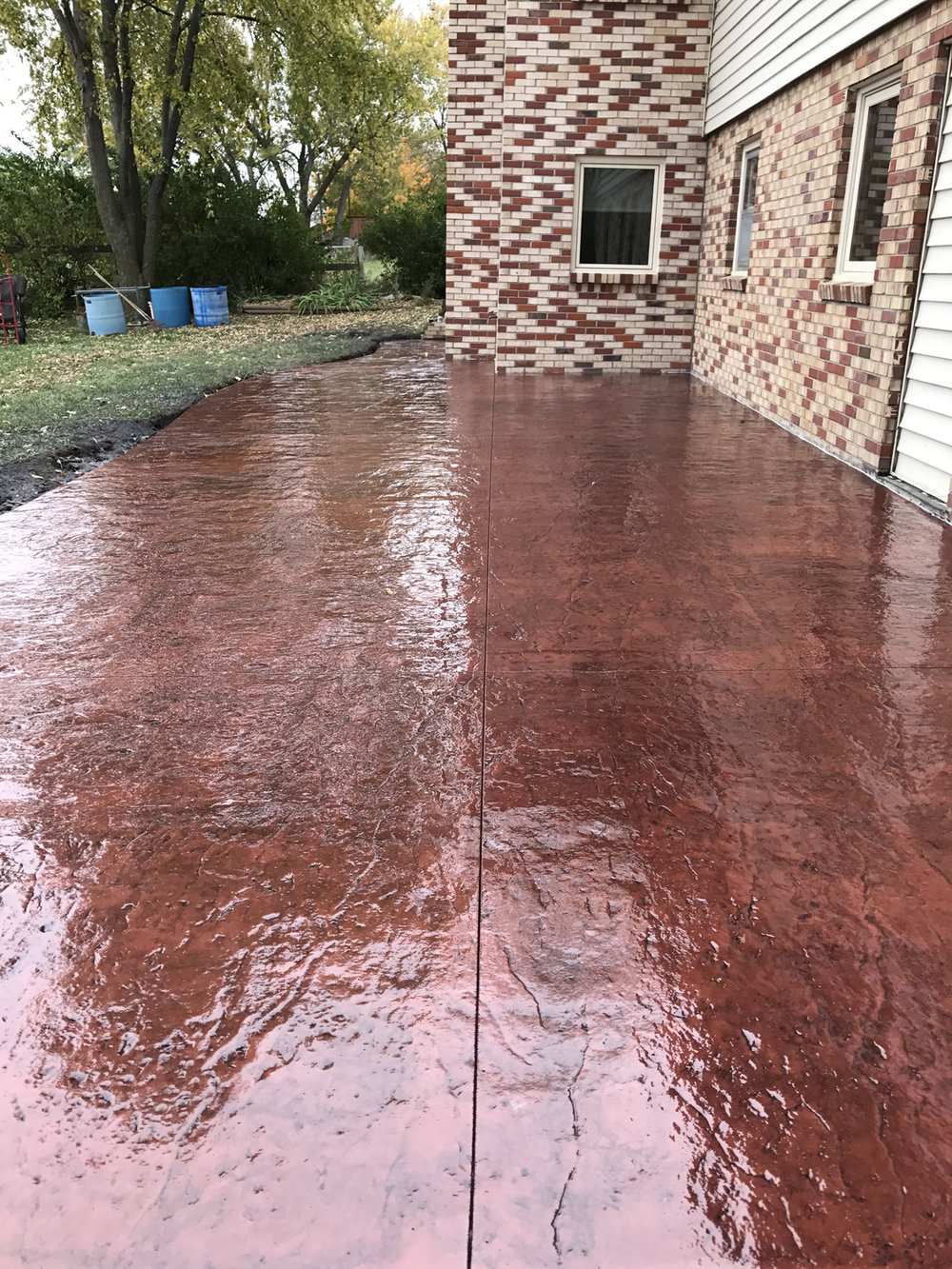 Tile red and medium gray stamped patio