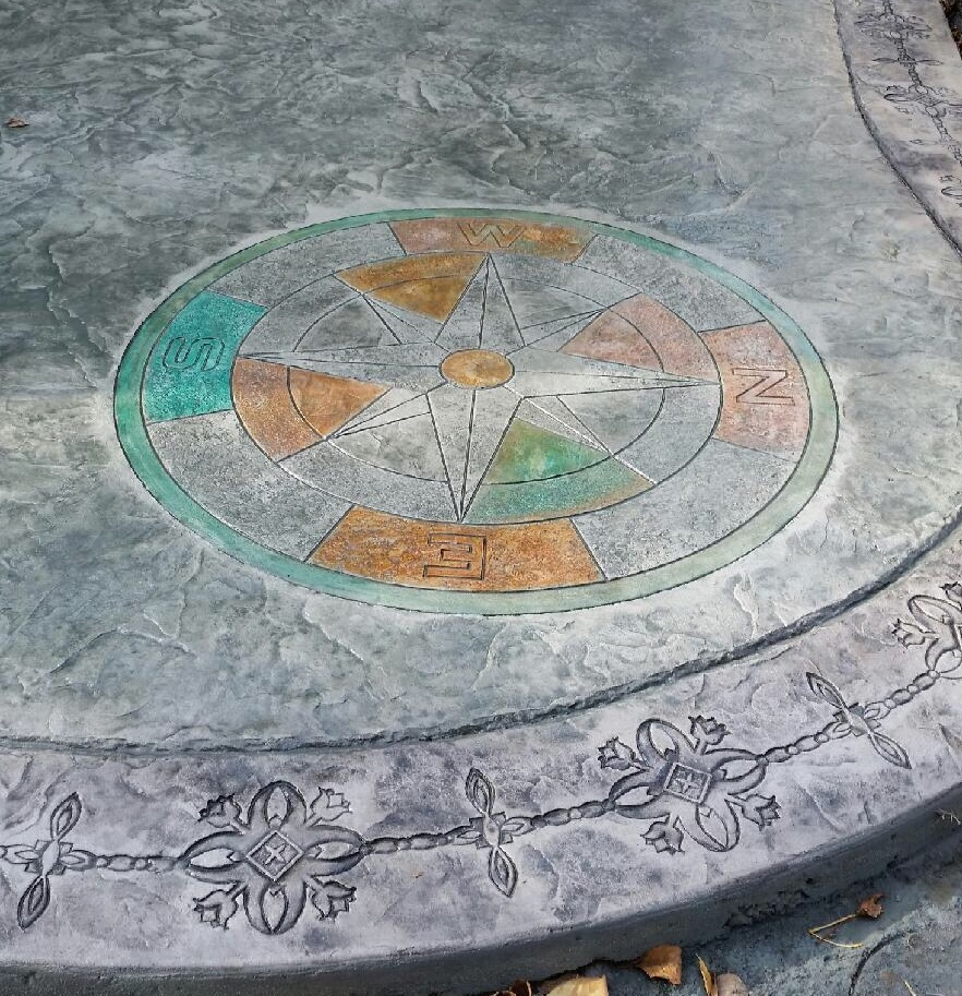 This patio used the Roman Slate Seamless stamp pattern with a decorative border and the Compass medallion.  Primary colors used were Light Gray highlighted by the Antique process.