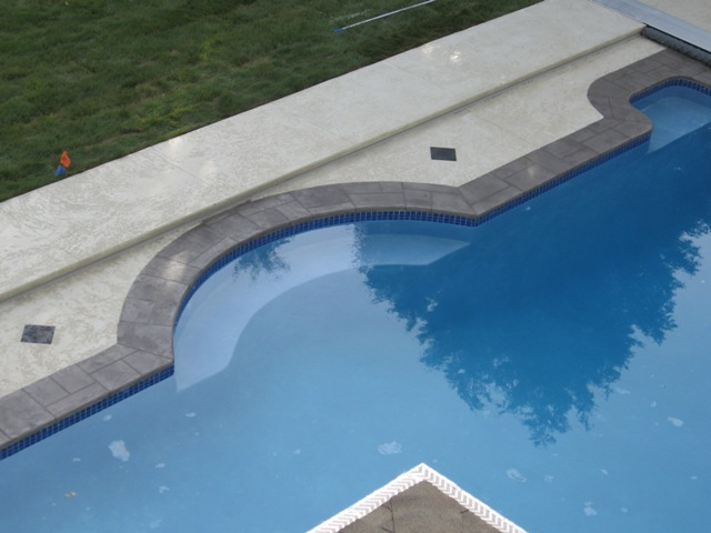 Decorative overlay (hand trowel and knockdown) around residential pool deck