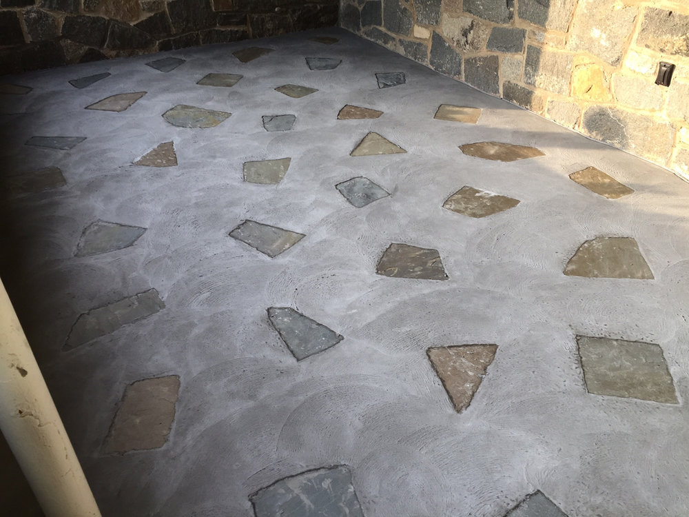 This picture shows a custom front porch, using SGS Integral color #920. For this project the customer choose to do a custom flagstone inlay, to match the existing stone building.