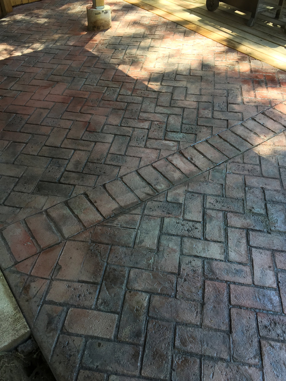herringbone used brick with brick boarder/ quarry red hardener/ light gray release/ brick form cure and seal