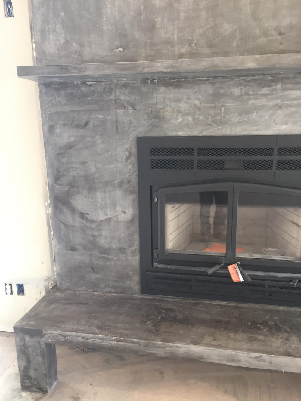 This is a custom fireplace that we did for a customer using natural concrete.