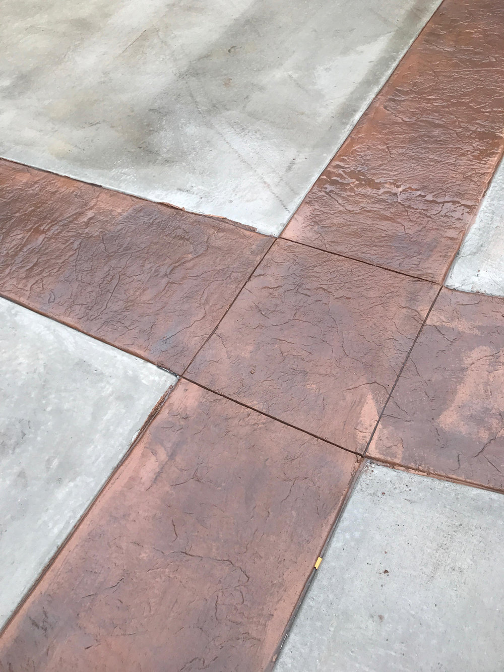 This is another picture of the custom driveway that we did using the colors Leather and Ginger. The color we use comes from Live Oak Hardware.