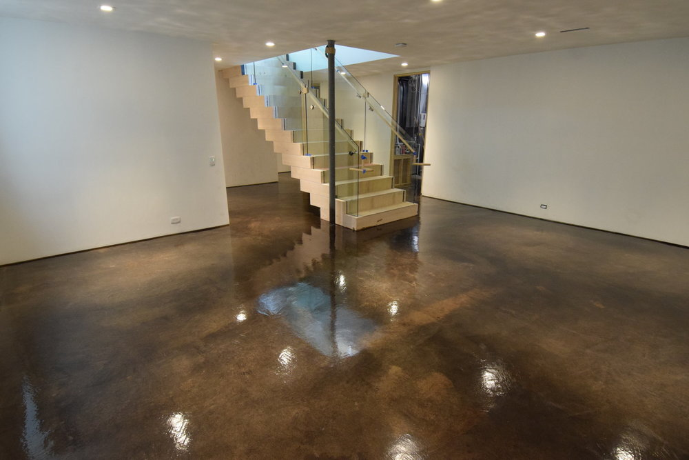 Acid-Stained Finished Basement Concrete Floor with Clear Sealer.  Brickform E-Stain.