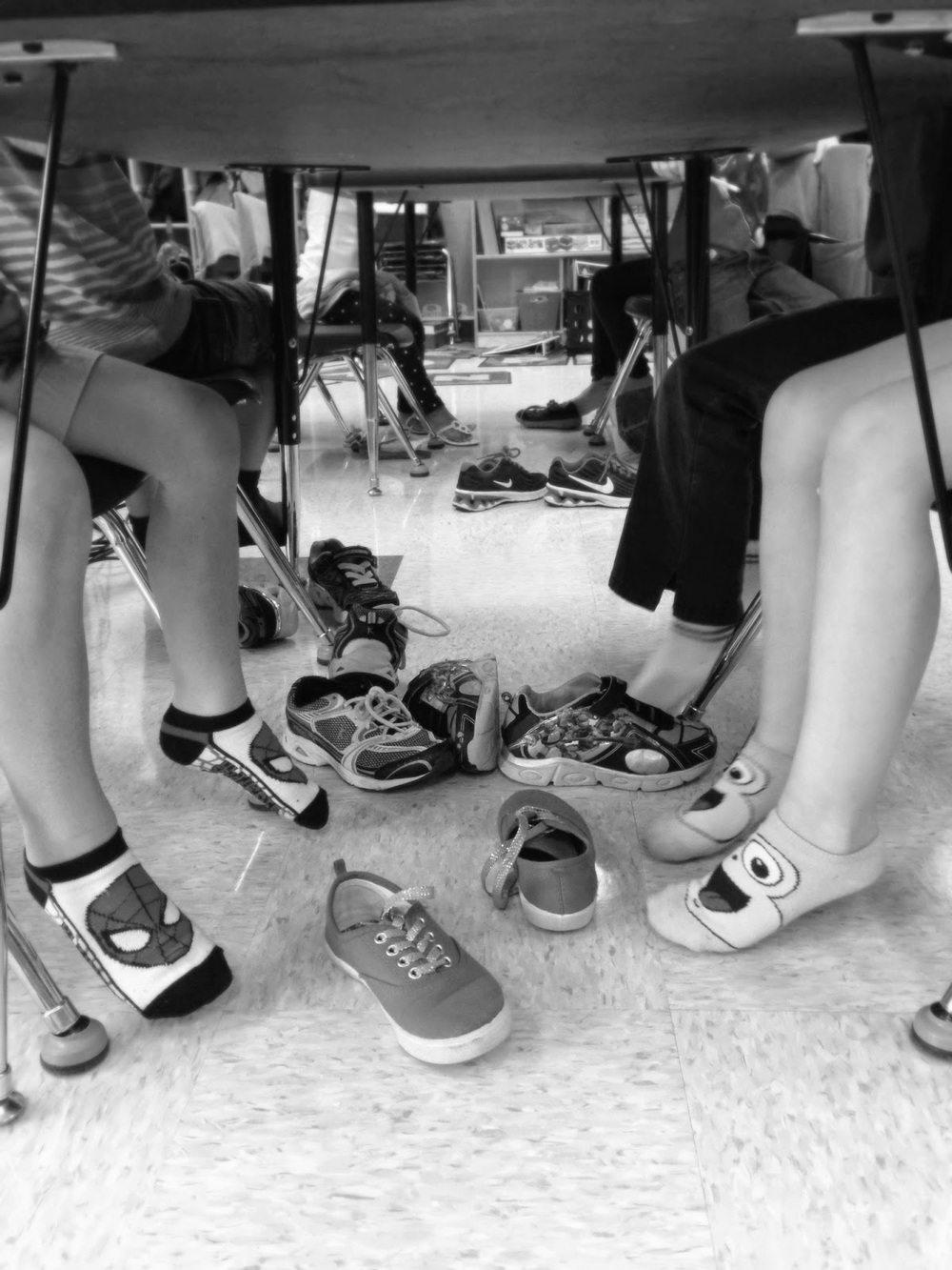 """The photo taken above was the first day I introduced this reward and all student got to """"test out"""" having their shoes off. However, I would strongly advise not having the whole class' shoes off for long periods of time. There will be a lot of shoes and laces flying everywhere if the fire alarm goes off!"""