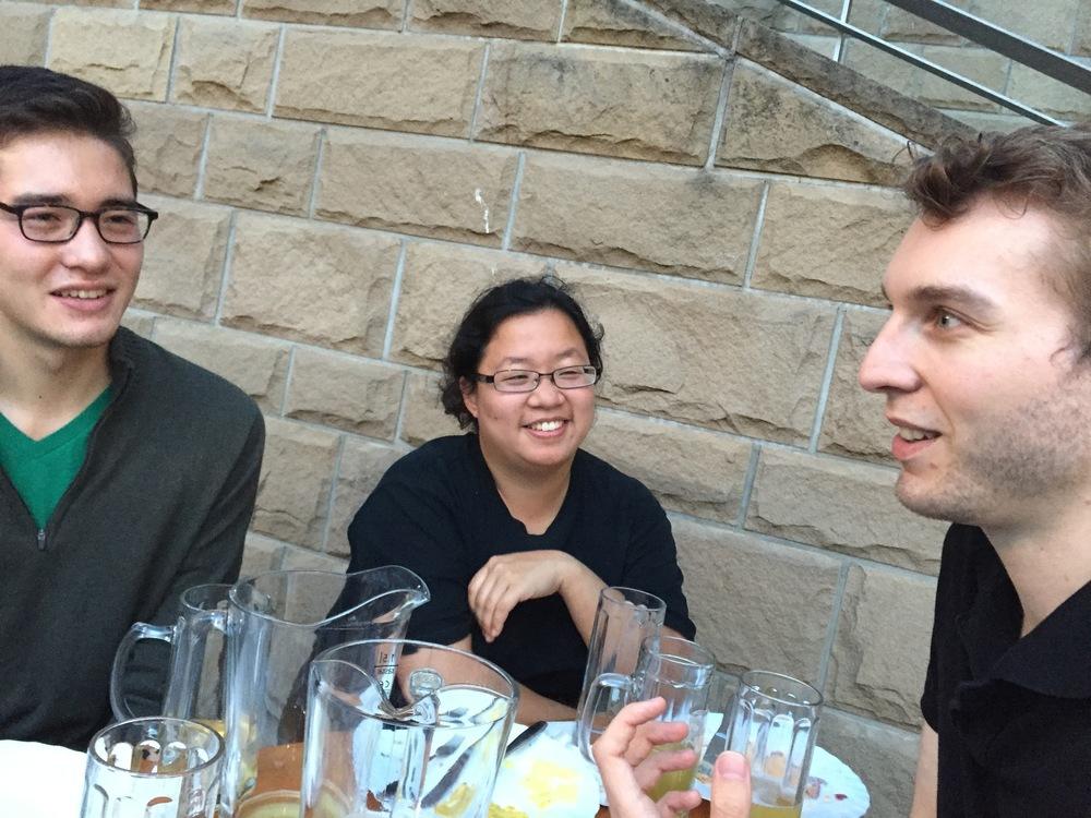 Noel, Jennifer, and Andrew enjoying German food at the Beer Garden along waterside.