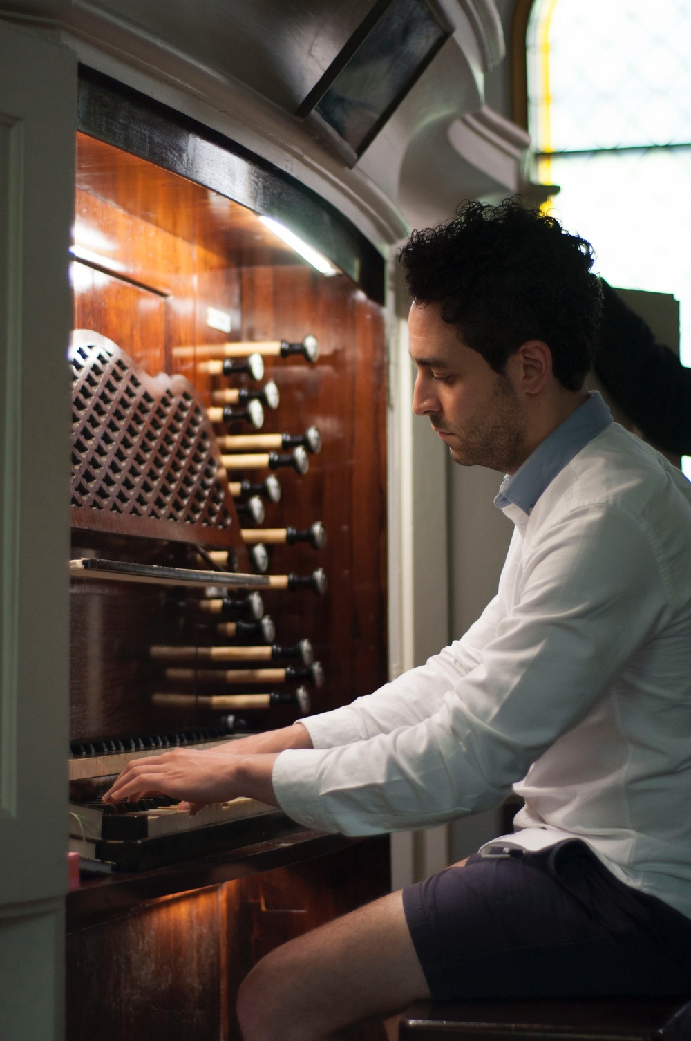 Gianmarco tries his hand at the Mendelssohn Organ's action.