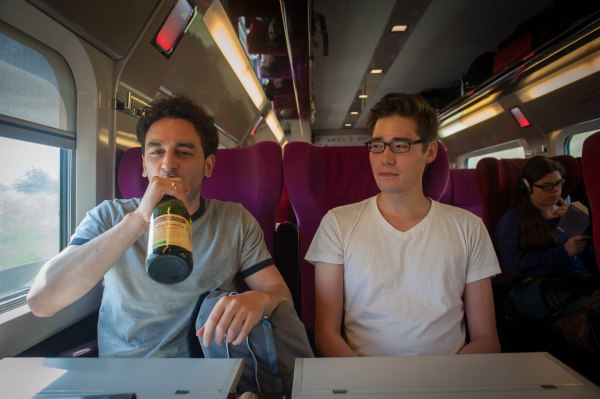Gianmarco sips cider on the train.