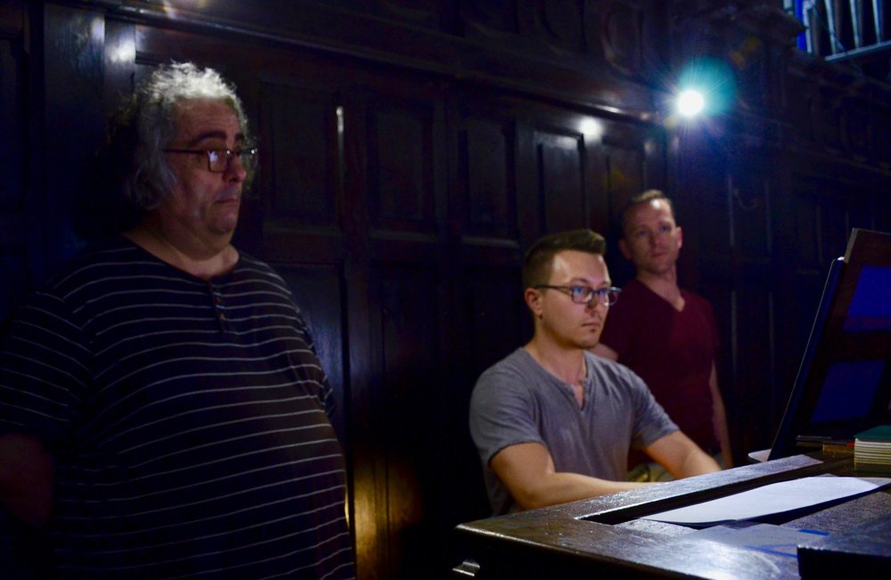 Corey De Tar plays the organ of Notre Dame du Taur, with Jean-Claude Guidarini and Christian Lane looking on.