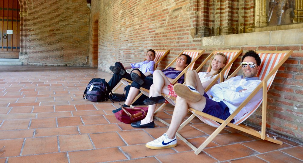 Gianmarco Massameno, Laura Gullett, Noel de Sa e Silva, and David von Behren relaxing in the cloister of Musee des Augustins, Toulouse.