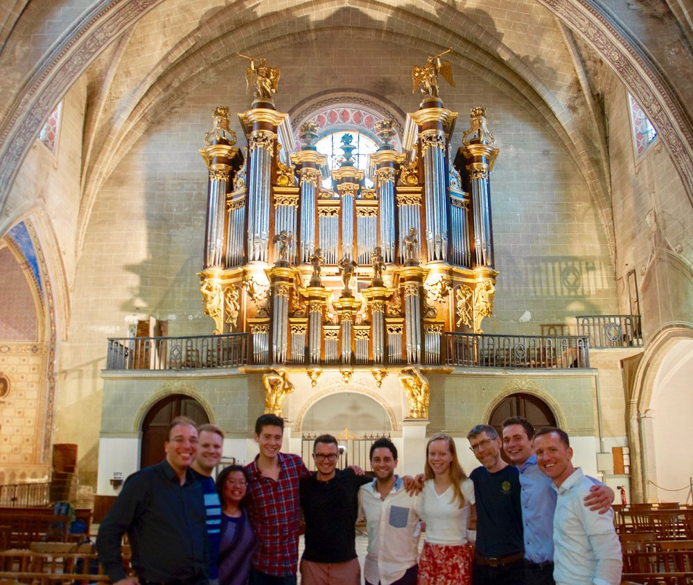 Members of Boston Organ Studio at the historic organ of Cintegabelle, France.