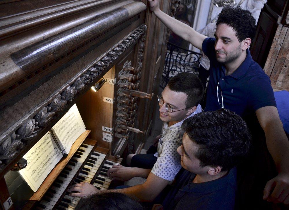 Noel de Sa e Silva, Corey De Tar, and Gianmarco Massameno at the organ in St Pierre des Chartreux, Toulouse