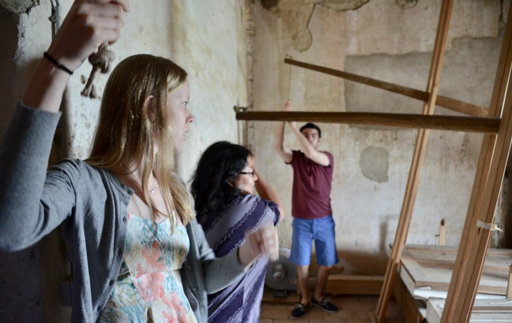 Laura Gullett, Jennifer Hsiao, and Brandon Santini pump the bellows of the French Classical instrument in St. Felix-Lauragais.