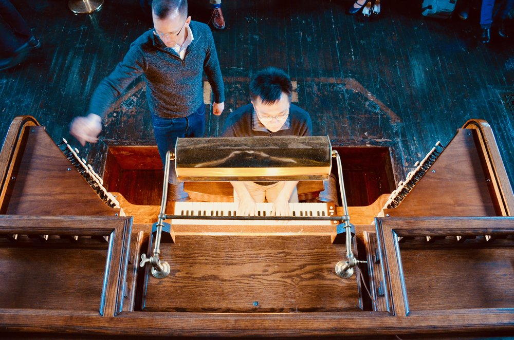 Adrian Cho at the Woolsey organ, assisted by Christian Lane