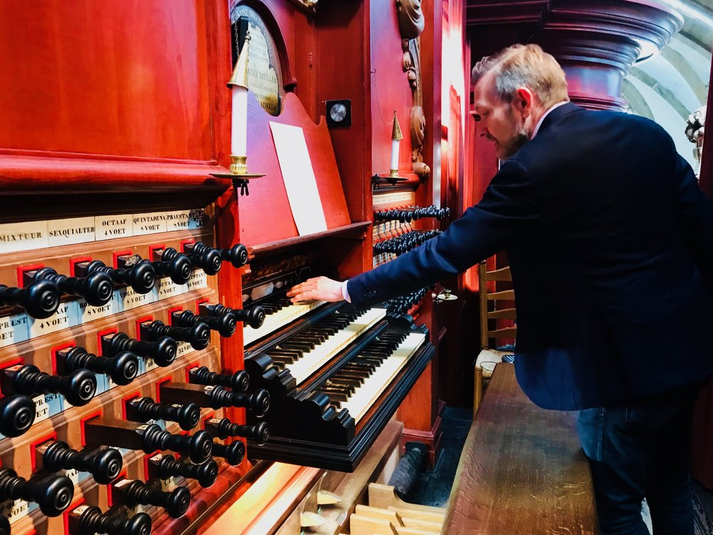 Resident organist Anton Pauw greets students of Boston Organ Studio and demonstrates the instrument in St-Bavo