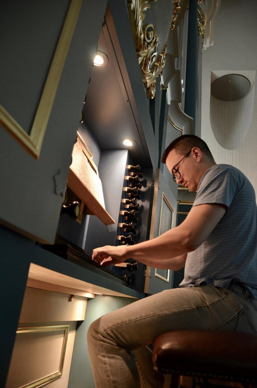 Corey De Tar at the console of the Baroque Organ in Orgelpark, Amsterdam. Boston Organ Studio.