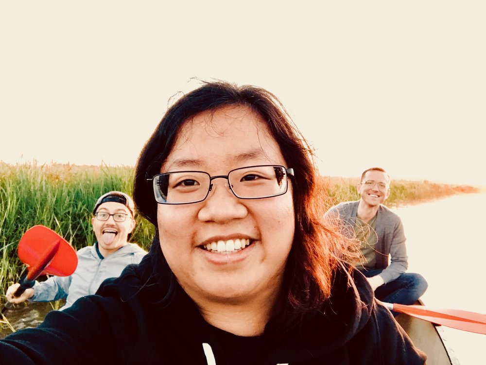 Corey De Tar, Jennifer Hsiao, and Christian Lane on the canal in Holland.