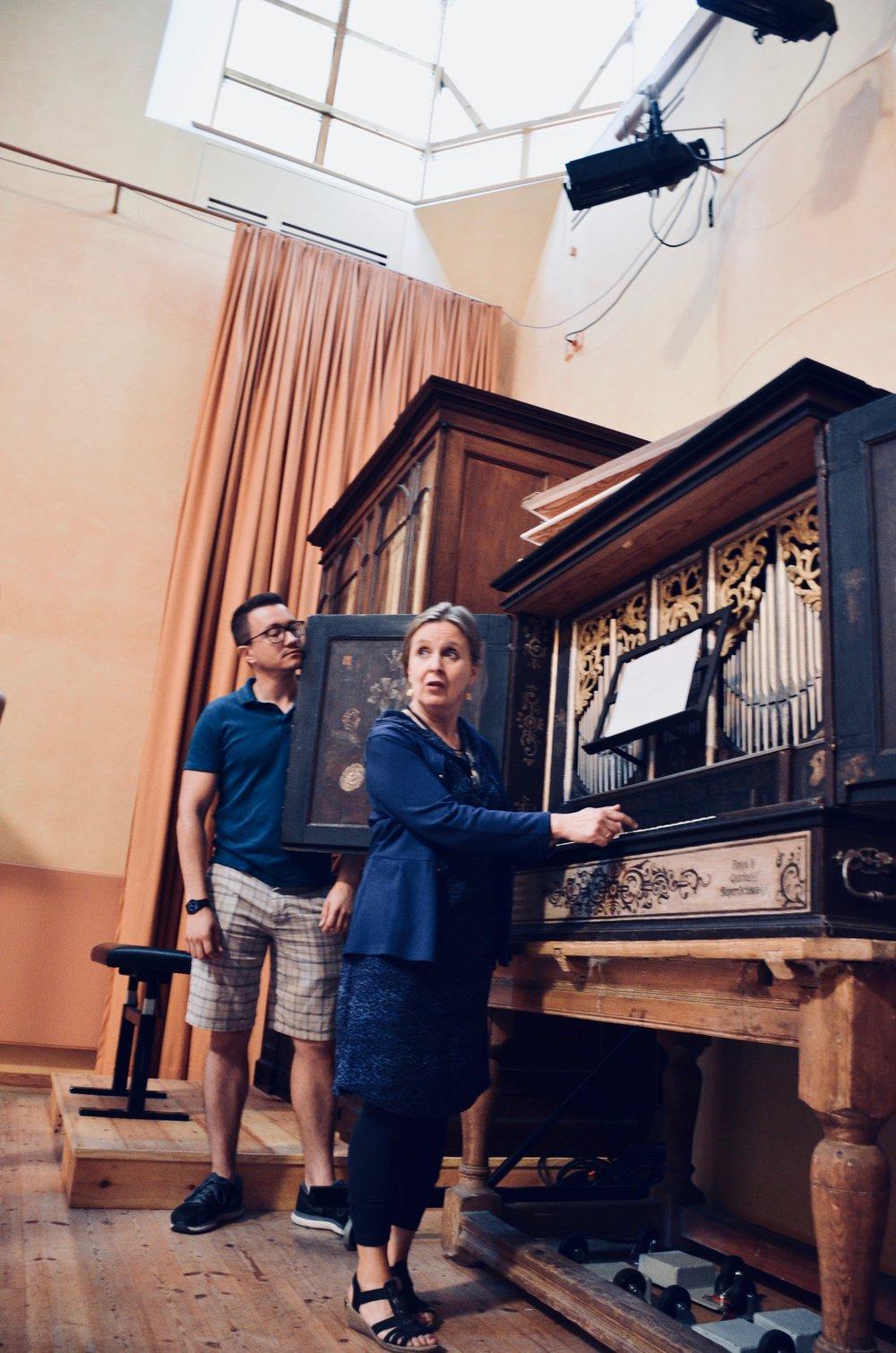 Corey De Tar pumps the 17th-c Manderscheidt organ for Prof. Karin Nelson in Göteborg University.