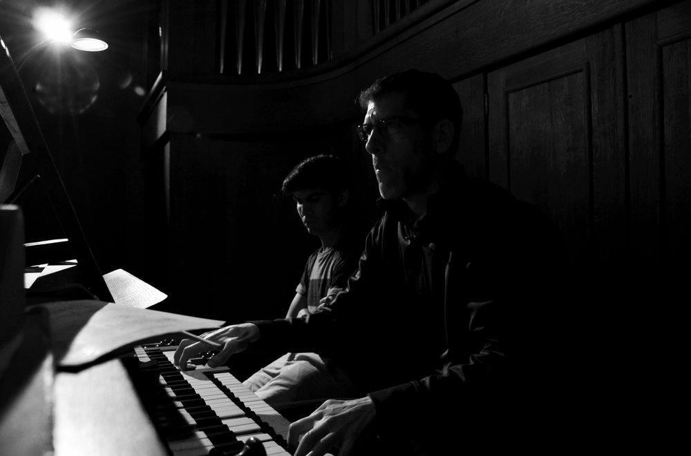 Chris Porter plays the 1998 Verschueren organ in Göteborg University while Brandon Santini looks on.